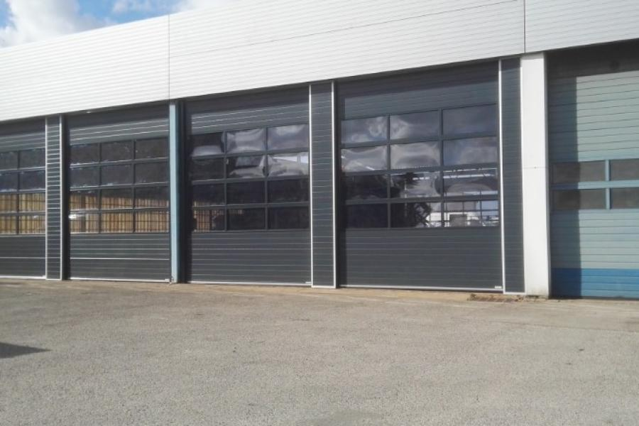 porte sectionnelle industrielle automatique , panneaux vitrés ,DUNKERQUE